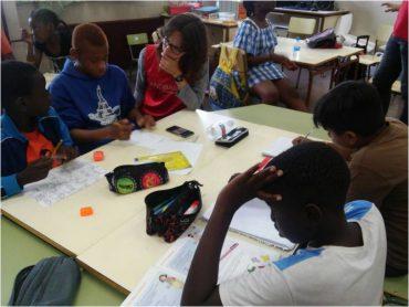 Andbank dia del niño Save the children niños en clase